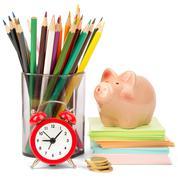 Alarm clock with piggy bank - stock photo