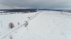 Fast flying over snow-covered roads, fields toward the horizon Stock Footage