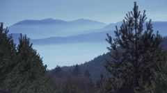 Spectacular mountain covered by fog Stock Footage
