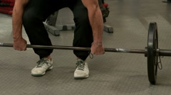 Stock Video Footage of Fit man lifting heavy barbell