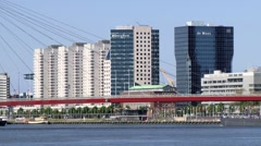 View to the Willemsbrug bridge and buildings in Rotterdam, Netherlands. Stock Footage