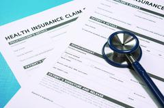 Health insurance claim form with stethoscope for insurance concept - stock photo