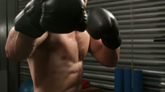 Fit man punching with boxing gloves Stock Footage