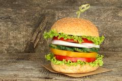 Healthy vegan burger with raw vegetables. Stock Photos