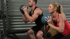 Stock Video Footage of Muscular couple doing ball exercise