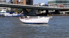 Man rides boat by the Mass river in Rotterdam, Netherlands. Stock Footage