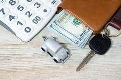 Car toy and key with calculator and money - stock photo