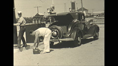 Vintage 16mm film, 1935, people, filling gas can at gas station... Stock Footage