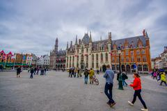 Bruges, Belgium - 11 August, 2015: Famous plaza Markt in city centre, sorrounded Stock Photos