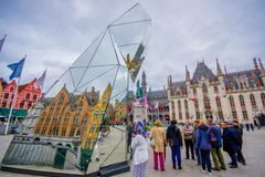 Stock Photo of Bruges, Belgium - 11 August, 2015: Famous plaza Markt in city centre, sorrounded