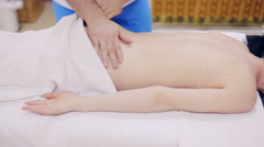 Massage therapist making massage of small of the back Stock Footage