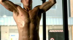 Muscular man lifting himself up and down Stock Footage