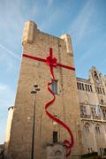 city hall of Narbonne with red ribbon for christmas decoration - stock photo