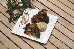 grilled beef with tomato. Gourmet Main Entree Course Grilled Lamb steak with  - stock photo