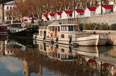 Quay with touristic boats in Narbonne Stock Photos