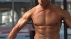 Stock Video Footage of Fit muscular man posing and looking to the camera