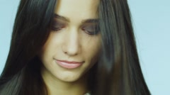 Portrait of a dark-haired girl slow motion video - stock footage