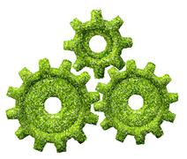 cogs or gears from the green grass. - stock illustration