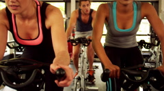 Stock Video Footage of Fitness group working out on exercise bike