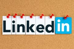 Linkedin logo sign printed on paper, cut and pinned on cork bulletin board Stock Photos