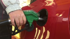 Red car at gas station - stock footage