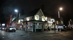 Traditional English pub at night Stock Footage