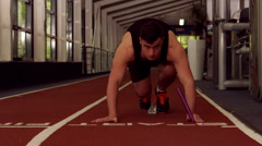 Stock Video Footage of Fit man running on indoor track