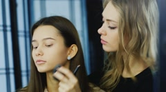 Young make-up artist at work - stock footage