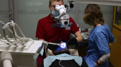 Girl lies in dental chair during dental treatment Stock Footage