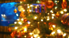Christmas tree and tv viewed throught the window from city downtown street. Stock Footage