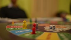 Board Game Cash Flow - a player throws the dice on the field and makes his move Stock Footage