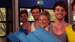 Fit group holding their fitness mat Stock Footage