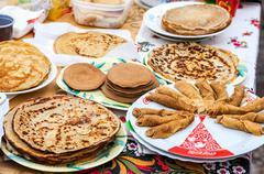 Appetizing fried pancakes ready for sale during Pancake Week - stock photo
