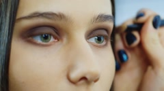 Close-up of a young woman: where to apply makeup Stock Footage