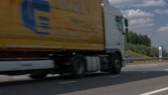 Ungraded: Yellow Truck Driving on Intercity Highways Stock Footage