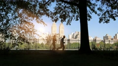 silhouette of people jogging in the city park. healthy lifestyle sports activity - stock footage
