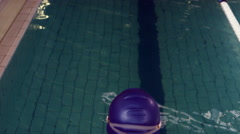 Rear view of swimmer diving into pool Stock Footage