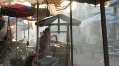 Foodstall in market early morning backlight,Siem Reap,Cambodia Stock Footage
