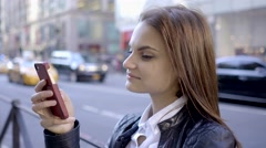 attractive business women using smart phone in the city commuting to work - stock footage