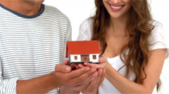 Stock Video Footage of Happy couple holding miniature house