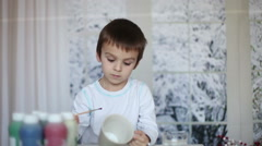Stock Video Footage of Cute little preschool boy, drawing picture on mug for his fathers birthday