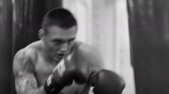 Fast and furious. Monochrome closeup shot of a boxer training with the punchi - stock footage