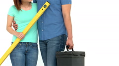 Smiling Asian couple holding diy tools Stock Footage