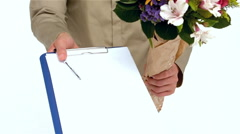 Postman holding flowers and handing document Stock Footage