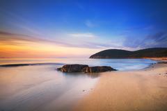 Sunset in Cala Violina bay beach in Maremma, Tuscany. Mediterranean sea. Ital Stock Photos