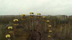 Ferris wheel in the exclusion zone. Flying around is close - stock footage