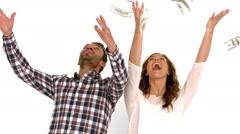 Happy couple throwing money Stock Footage