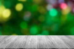 Wood terrace and Blurred of Abstract bokeh background of Christmas tree - stock photo