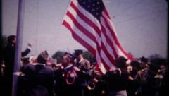 3032 veterans raise American flag, band plays - vintage film home movie Stock Footage