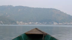 The bow of the boat aimed towards the city Stock Footage